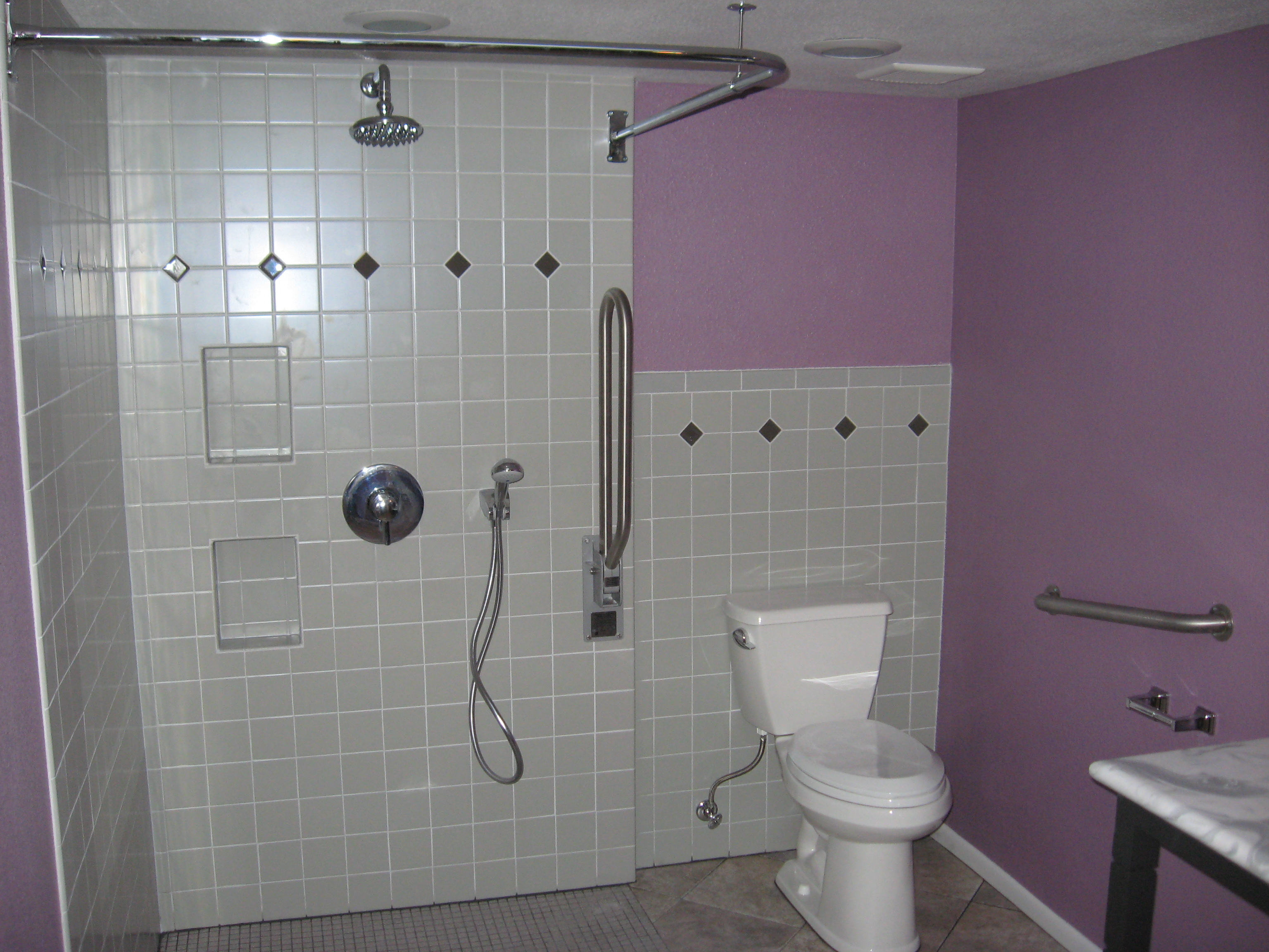 tiled bathroom shower and toilet image
